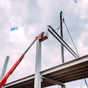 details-of-construction-site-with-crane-lifting-pr-PHCEKUA
